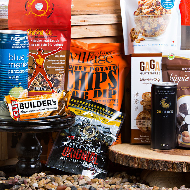 A crate for the manly man, that is on the go. Packed full of protein, natural sugars, and essential carbs, he will be impressed how healthy this pack is. Send this one in a hurry! Gift Includes: •	Keepsake Canadian Made Manbox •	Chocolate Cashew Gluten Free Hippie Cookies •	Balsamic & Cracked Pepper Chick peas •	Crunchy Peanut Butter Builders Bar •	Pineapple & Cocoa Organic Buck Wheat Snack •	Gluten Free Vanilla Almond Granola •	Gaga Gluten Free Chocolate Chip Cookies •	Blue Monkey Pure Coconut Water •	28 Black Acai Energy Drink •	Sweetseeds - Salba Chia Snack Bar  •	Crack House Snack Pack Jerky •	Turkey Jerky •	Sweet Potato Kettle Chips