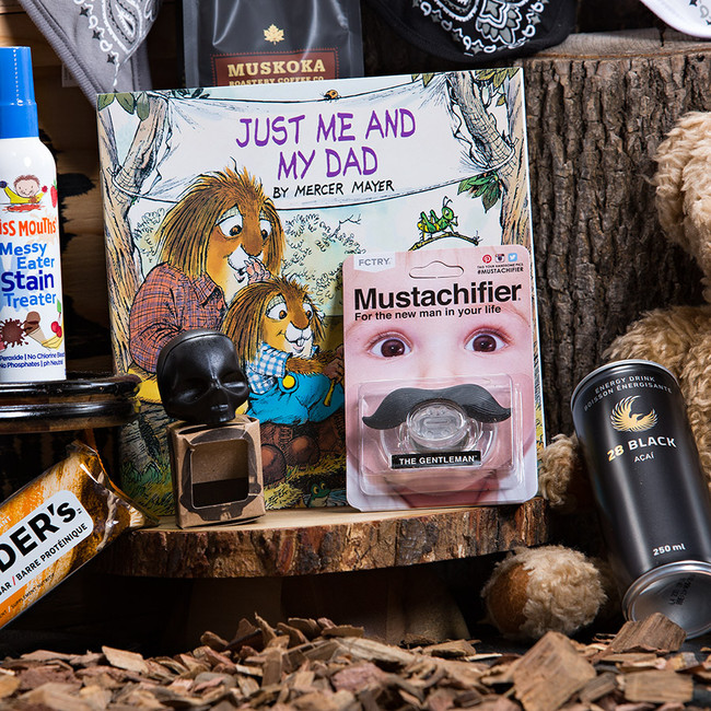 MANBOX for the new dad! We have everything covered here. From a new dad's survival guide, to bandana bibs for baby, poo-pourri spray for those stinky diapers, coffee to help get through those first few months, energy drinks to get through the long days, and more! Gift Includes: •	Keepsake Canadian Made Manbox Gift Experience •	28 Black Acai Energy Drink •	Gatorade Recover Protein Shake Chocolate  •	Crunchy Peanut Butter Builders Bar •	Muskoka Roastery Howling Wolf Ground Coffee •	The New Dad's Survival Guide •	Just Me and My Dad Story Book •	Skull Lip Balm •	Bandana Bib, Black-Grey-White Set of 3  •	Mustachifier, The Gentleman  •	Miss Mouths Messy Eater Stain Treater  •	 Royal Flush Poo-Pourri Spray