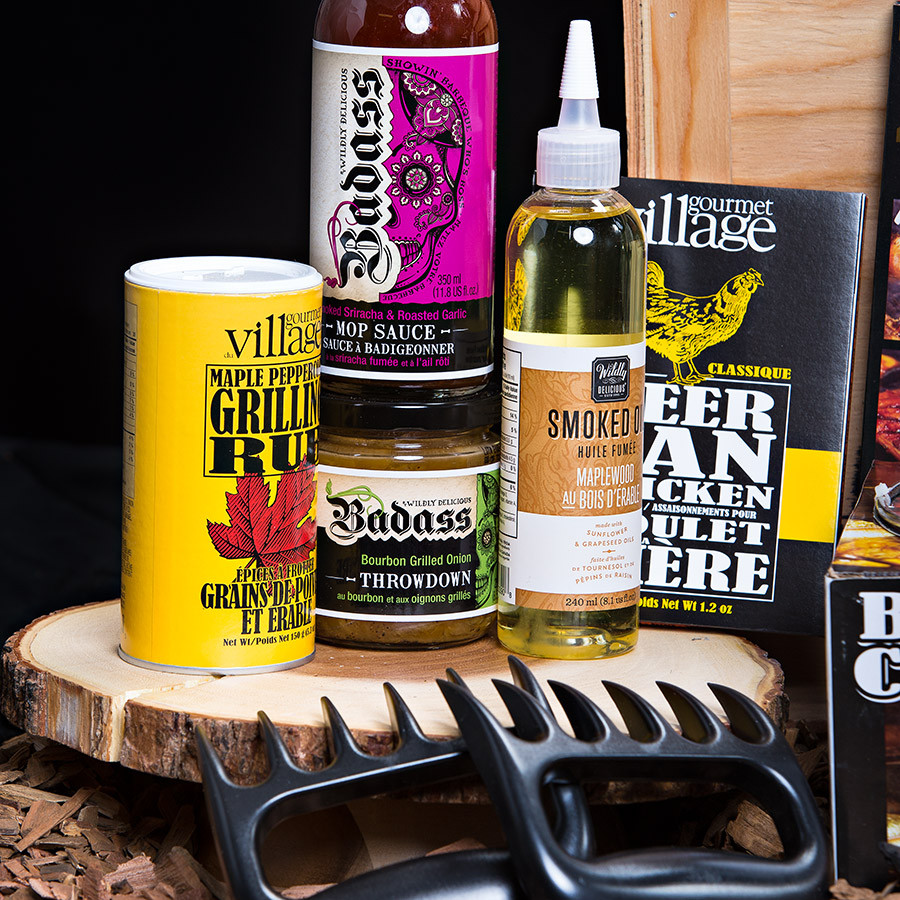 """An Ultimate gift for the PIT MASTER!  A grill masters dream with all the essentials to kick off BBQ Season. Gift Includes: •Keepsake Canadian Made Manbox •19 Crimes Shiraz Durif •Ancho Chili and Coffee Meat Rub •Maplewood Smoked Oil •Smoked Sriracha and Garlic BBQ  Mop Sauce •Newfoundland Screech BBQ Sauce •Bourbon Grilled Onion Throw down •Applewood Smoke Finishing Salt •Maple Peppercorn Grilling Rub •Beer Can Chicken Rub •Spicy Chipotle Burger Seasoning •Cedar Grill Plank & Spicy Texan Rub •BBQ Rub Trio •Beer BBQ Grilling Sauce •Stuffed Burger Press •Beer Can Chicken Roaster Kit"""" •Bear Paw Meat Shredding Claws"""