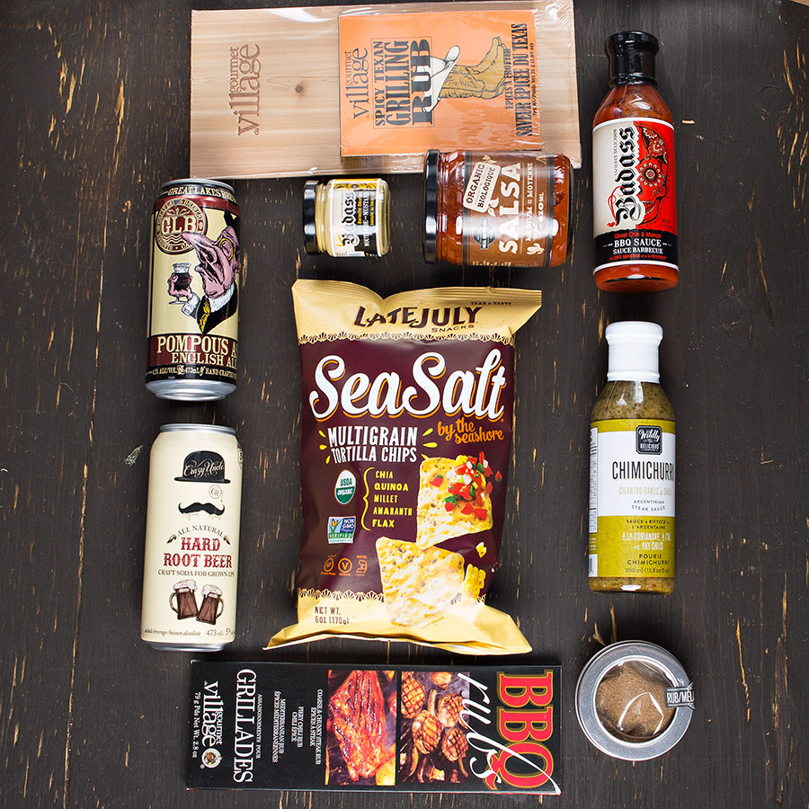 A simplistic box for the perfect evening BBQ with friends! Gift Includes: •Keepsake Canadian Made Manbox Gift Experience •Peppercorn Steak Rub •Cedar Grill Plank & Spicy Texan Rub •BBQ Rub Trio •Chimichurri Sauce •Mango Haberno Throw Down Sauce •Smoked Ancho Mustard •Late July Organic Multigrain Snack Chips - Sea Salt by the Seashore •Neal Brother's Organic Medium Salsa •Crazy Uncle Hard Root Beer •Great Lakes Pompous Ass