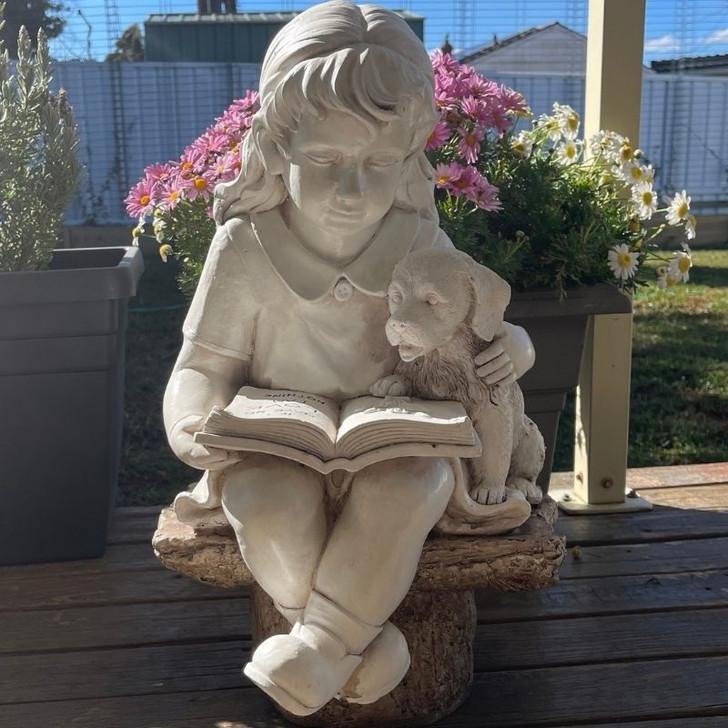 Girl reading to her dog garden statue 55cm