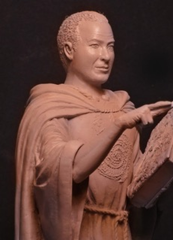 Picture shows prototype statue. Shipping model has long hair