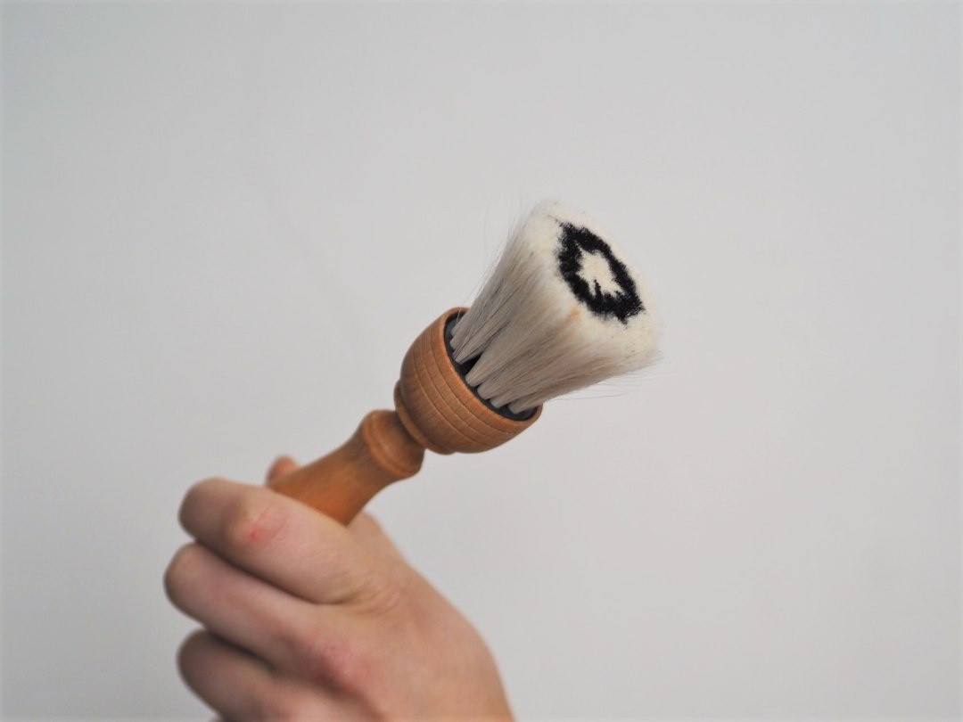 Delicate hand-crafted dusting  brush