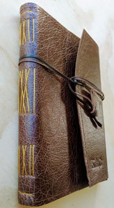The Aussie Travel Journal.  Handcrafted and hand stitched in Australia. Kangaroo leather wrapping strap.