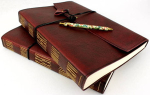 Chesterfield Ruby leather hand stitched journals. Handcrafted in Australia.