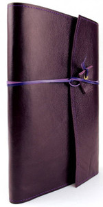 The original Book Wrap shown here in rich violet purple. Handcrafted in Australia. Kangaroo leather wrapping strap hold the contents securely and adjusts to the thickness. Designed to give many years of enjoyment.