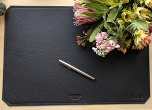 Black leather desk mat - monogrammed.  Pen is for display purposes only to show a sense of scale.