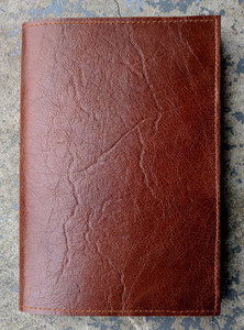Handcrafted leather cover.  Shown here in Cognac