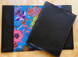 Handcrafted leather Moleskine cover lined with beautiful Liberty of London fabric. Shown here in black leather with Fantasy Land Lining.  Handmade in Torquay Australia.