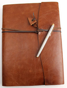 The Book Wrap A4 size is handcrafted in Australia from quality genuine leather. A kangaroo leather wrapping strap holds contents in place.