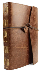 Hand made quality cowhide leather journal in Antique Oak. Wrap around style with kangaroo leather wrapping strap and leather toggle.