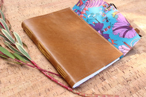 Hand stitched journal in genuine leather - Butterscotch colour. Fabric lining inside of Liberty of London - Fantasy Land design. Hand made in Torquay Australia.