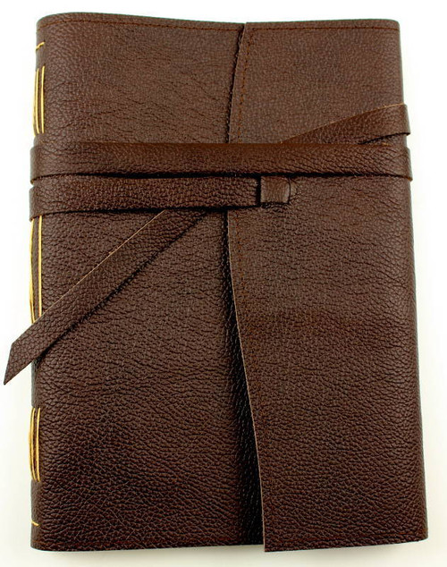 Hand stitched leather journal. Genuine cow hide leather in Espresso.  Hand cut wide wrap around strap. Italian paper hand stitched into spine.  Made with love by a book lover in Torquay Australia.