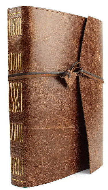 Hand made quality cowhide leather journal in Antique Oak. Wrap around style with kangaroo leather wrapping strap and leather toggle. Spine features hand dyed antique gold coloured thread to hand stitch the pages. Larger A4 size wtih 256 pages of watermarked archival paper. Ideal gift.