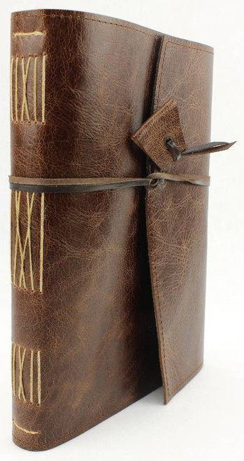 Antique Oak Leather Journal A5 size. Handmade in Australia. Kangaroo leather wrapping strap and toggle.  Antique gold coloured thread is used for stitching on the spine. Archival watermarked paper.