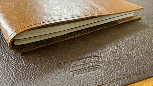 Handmade genuine leather Moleskine Cover.  Can hold two notebooks.