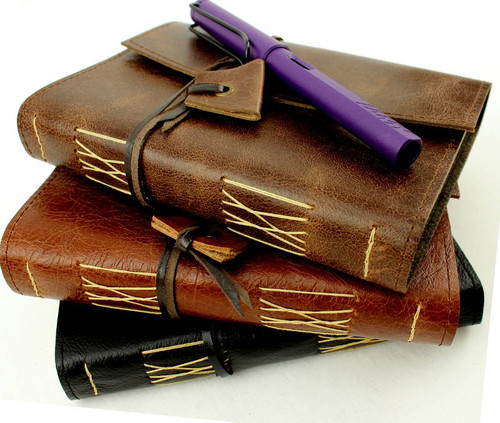 Leather Aussie Travel Pocket Journals are handcrafted in Australia by a book lover. Soft and supple with the hand stitched pages being stronger than glue. The leather pocket journal can go where hard cover books just can't take it. Available in a range of leathers.