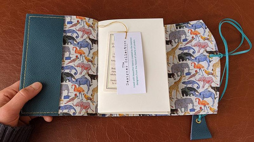 Sea Blue A6 leather journal lined with the beautiful Liberty fabric - Queue for the Zoo_White.  By the popular UK Illustrator OK David.