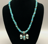 Butterfly pendant on a turquoise strand