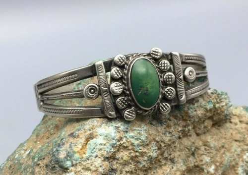 A hand made Fred Harvey era cuff, with green turquoise stone.