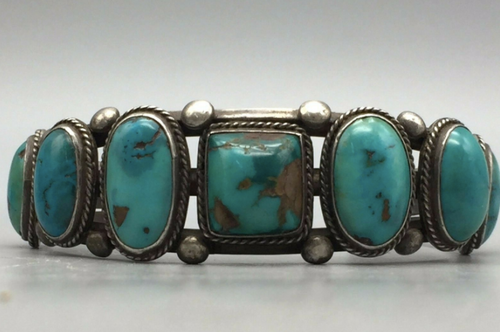 Statement turquoise cuff set with 7 stones.