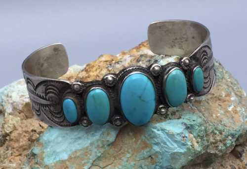 Vintage stamped cuff with five turquoise stones.