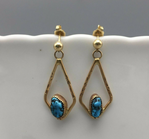 14k gold earrings set with dark blue turquoise
