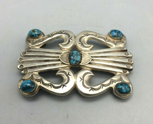 Sandcasted belt buckle with turquoise
