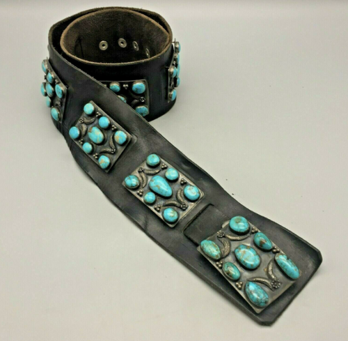 gorgeous black leather concho belt is highlighted by beautiful turquoise adorned conchos
