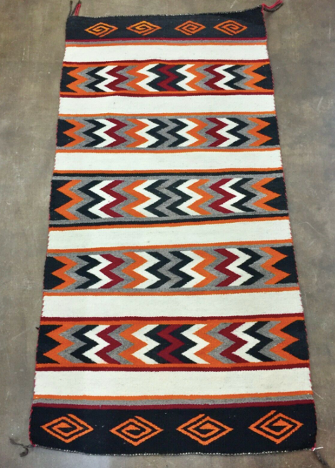 brightly colored older textile that was handmade by a talented Navajo weaver