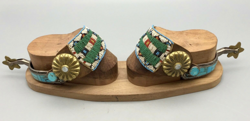 Turquoise inlay spurs with beaded straps