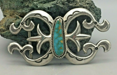 Sand cast buckle with turquoise
