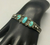 Fred Harvey Era three turquoise stones and sterling silver bracelet