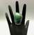 green stone which looks like it is half turquoise and chrysocolla (we're not 100% sure of that, but it does happen) ring