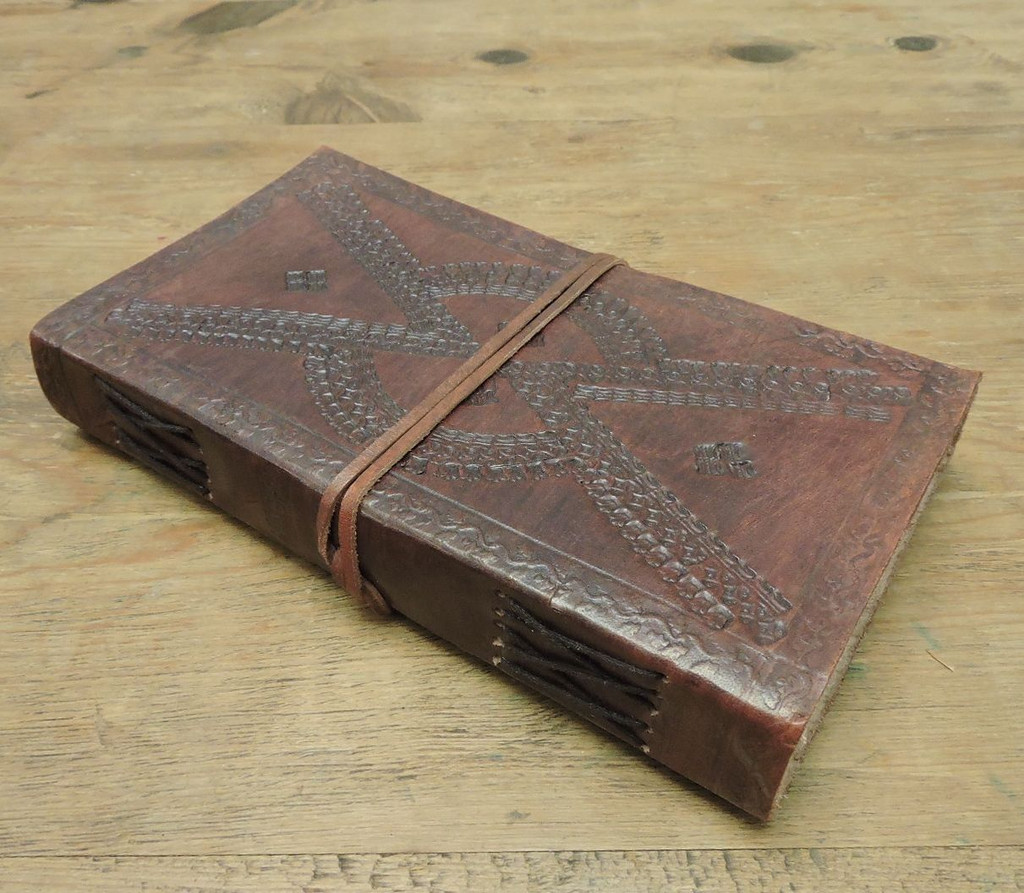 side view of leather journal - lined paper with embossing