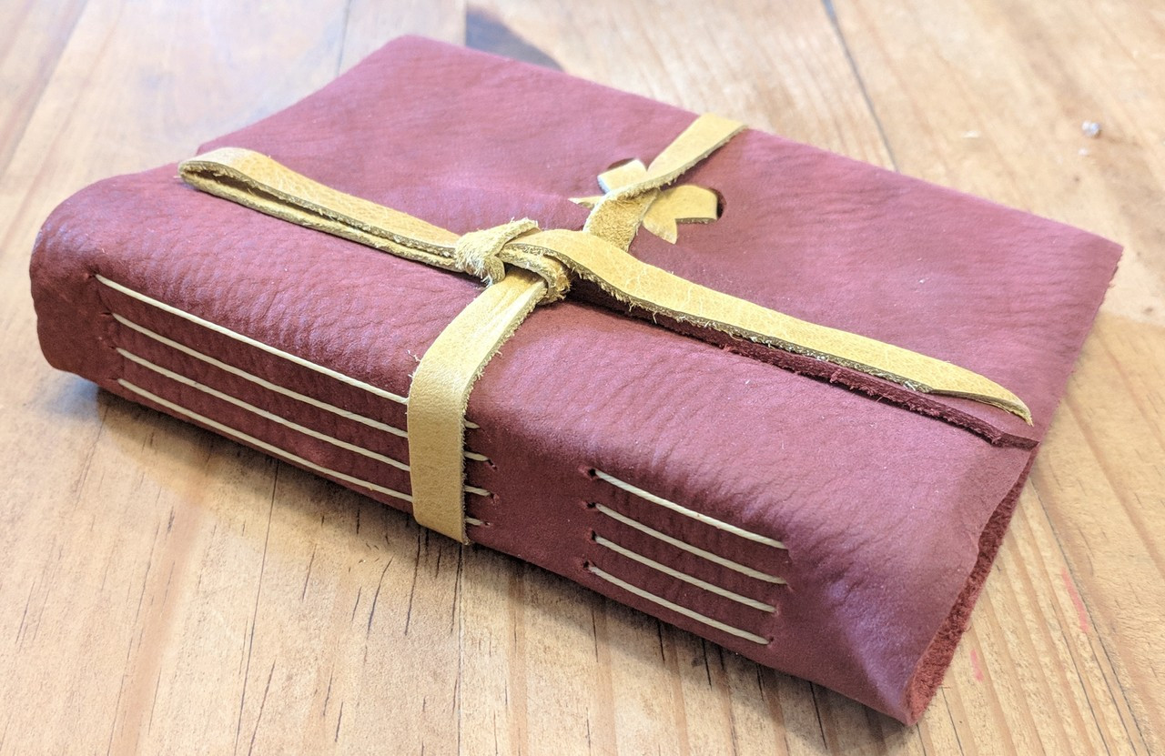 side view off spellbinding journals - small red
