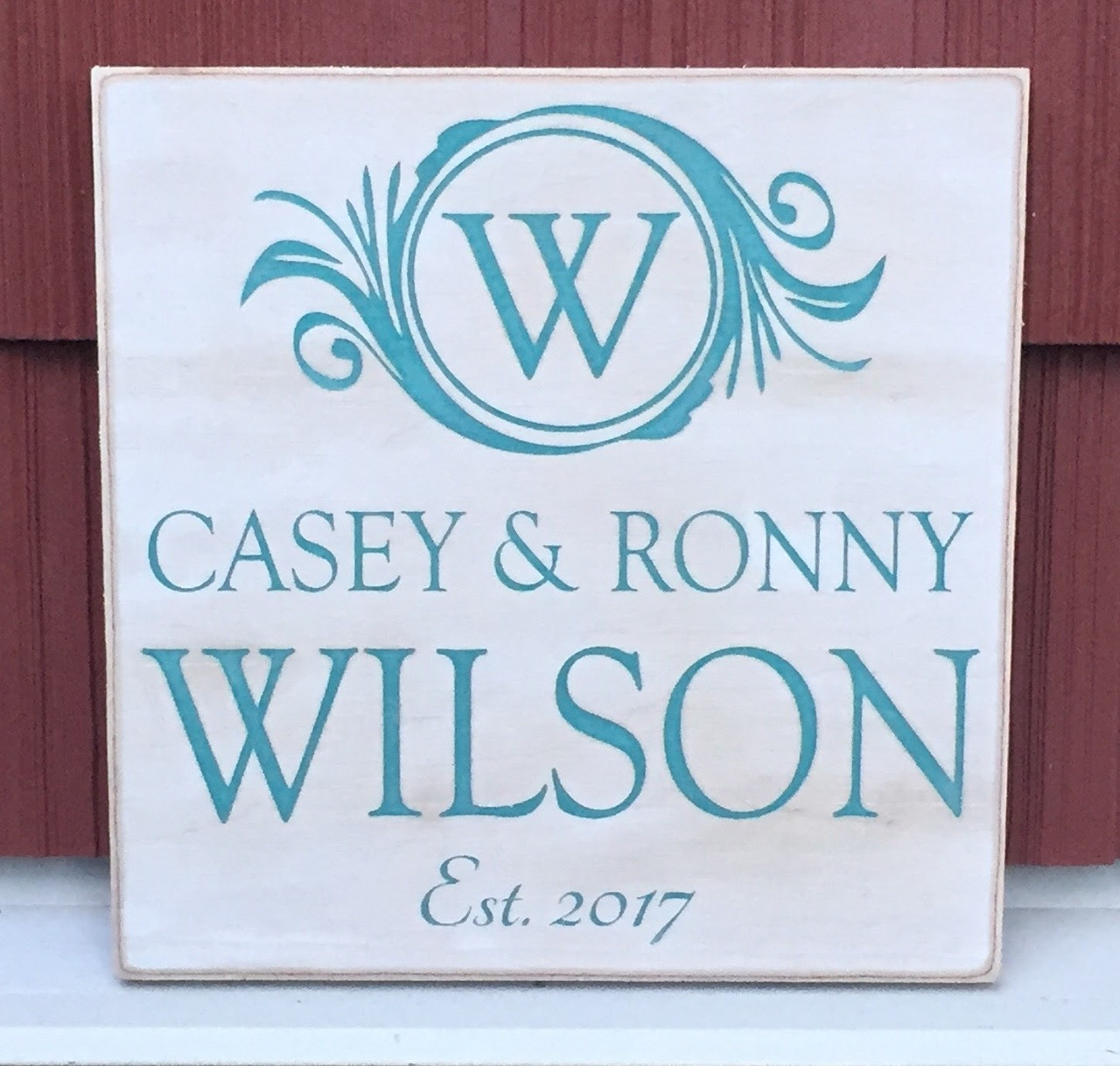 family establishment wood sign with monogram