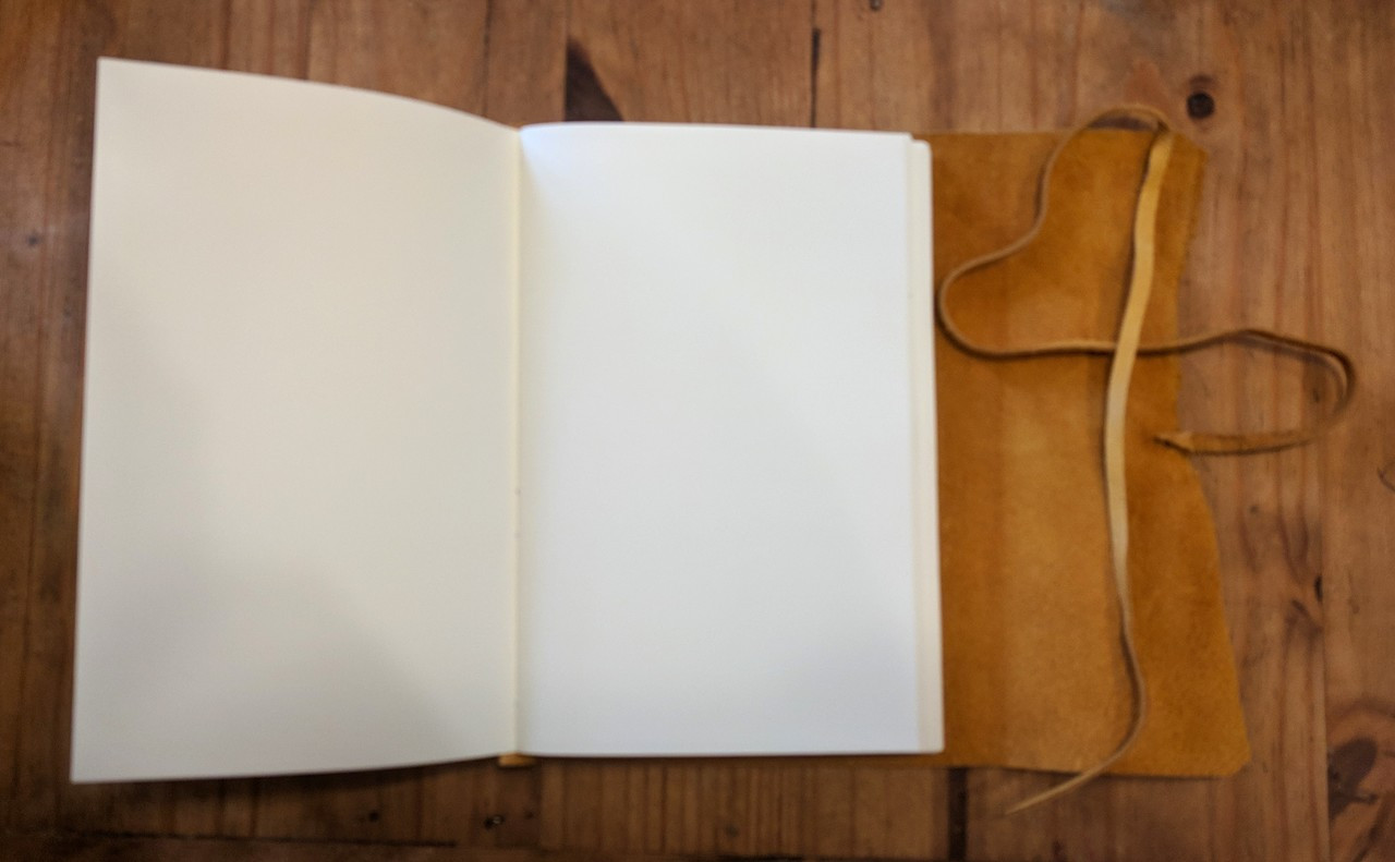 blank archival quality paper in spellbinding journals