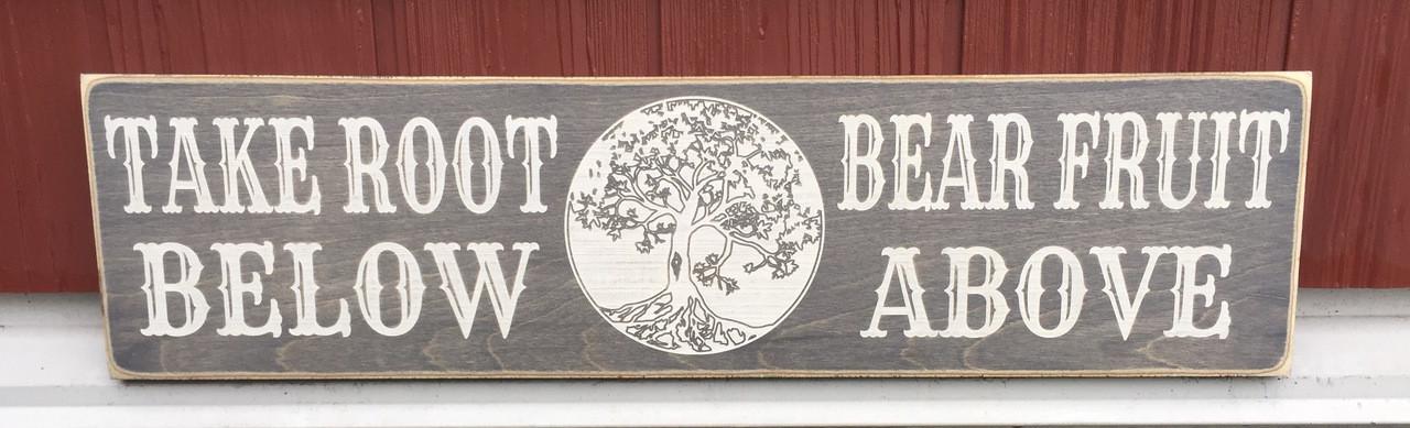 Take Root Below Bear Fruit Above Sign