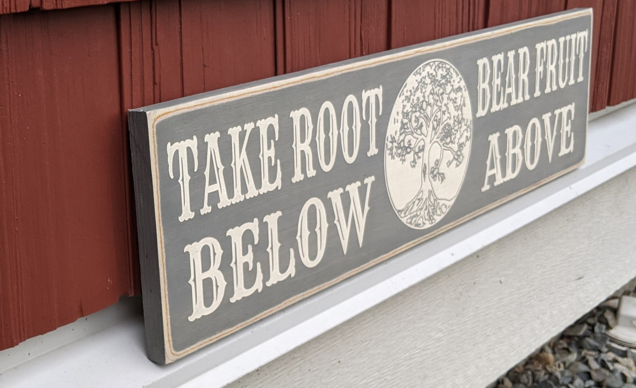 Take Root Below Bear Fruit Above Sign - side view
