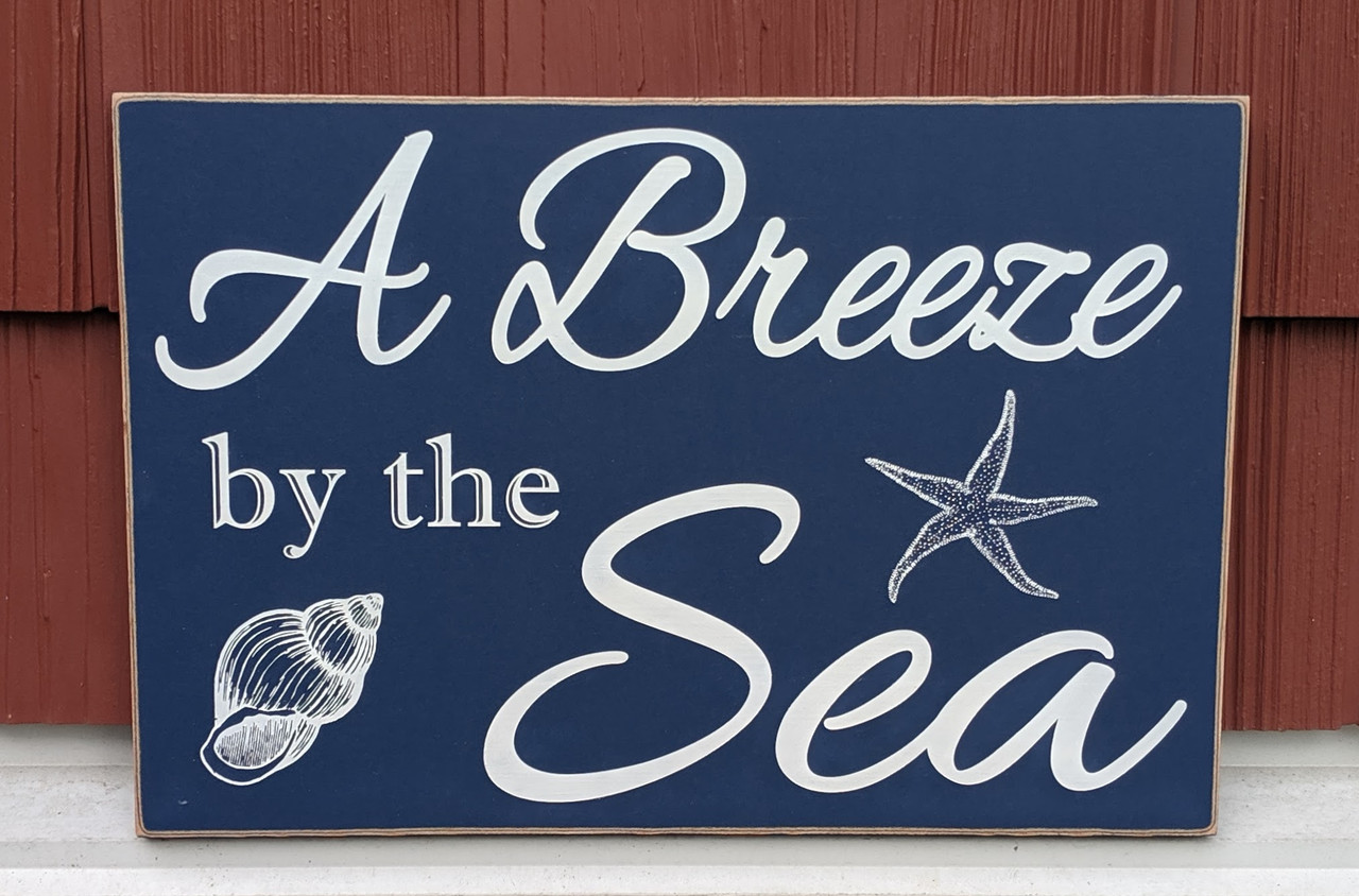 Cabin sign - A breeze by the sea