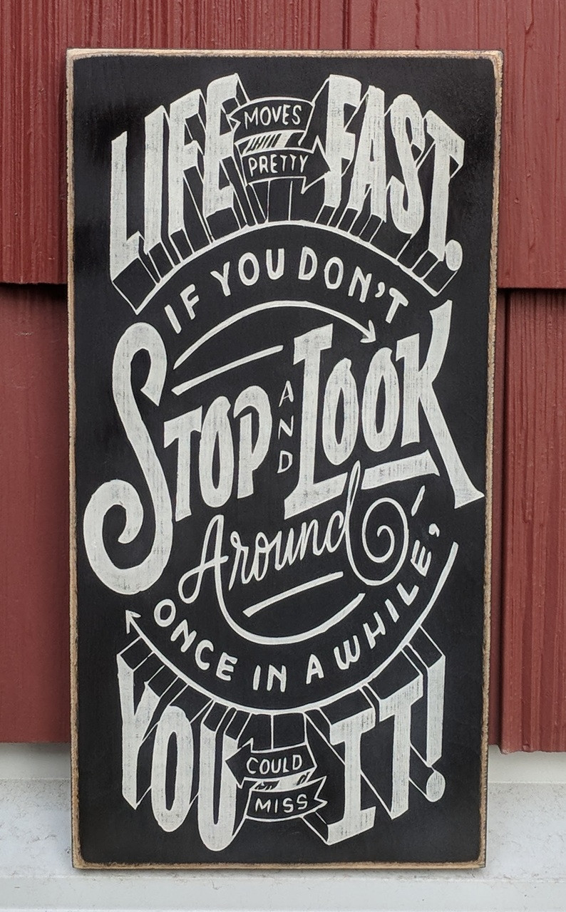 Life moves pretty fast. If you don't stop and look around once in a while you could miss it - wood sign - ferris bueller