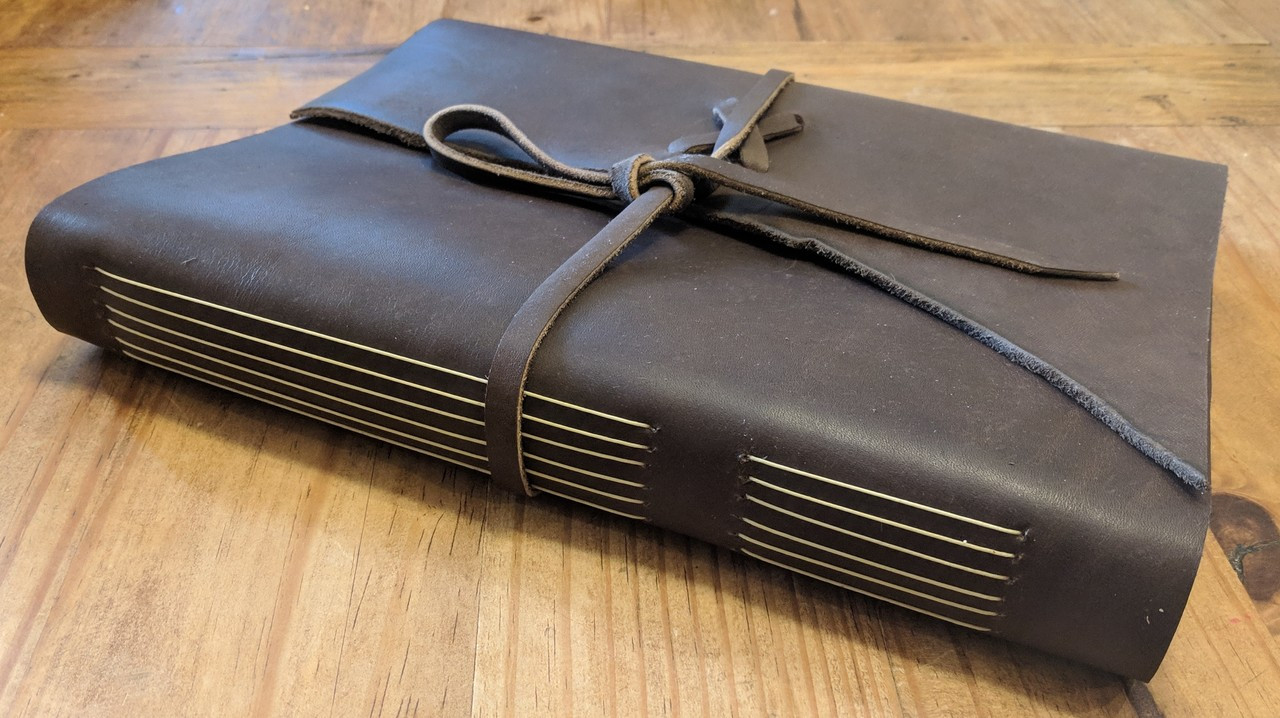 "Side view of Spellbinding Journals - Venetian Style Leather Journal - Large Brown - 8.75"" x 11.5"""