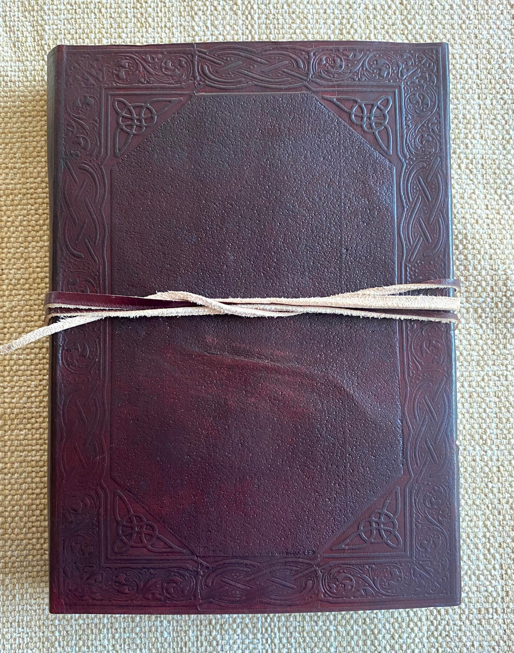weakened pinched leather on outside back cover
