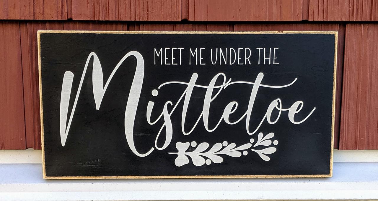 Meet me under the mistletoe sign