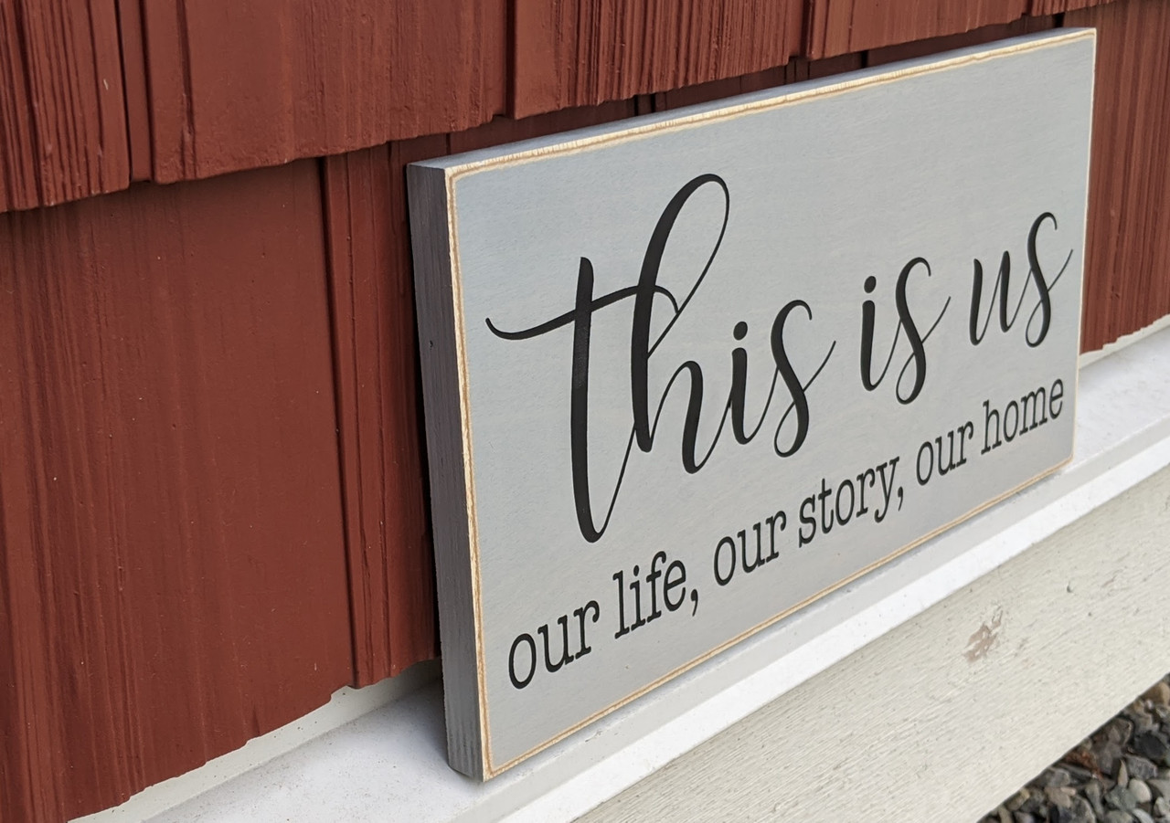 Side view of This is us - our life, our story, our home - sign