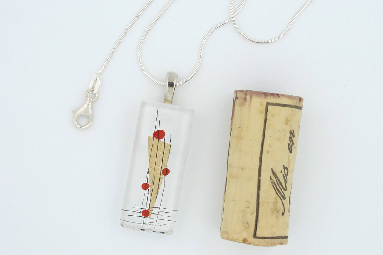 Momo Glassworks Poppy Perspectives Glass Pendant next to cork