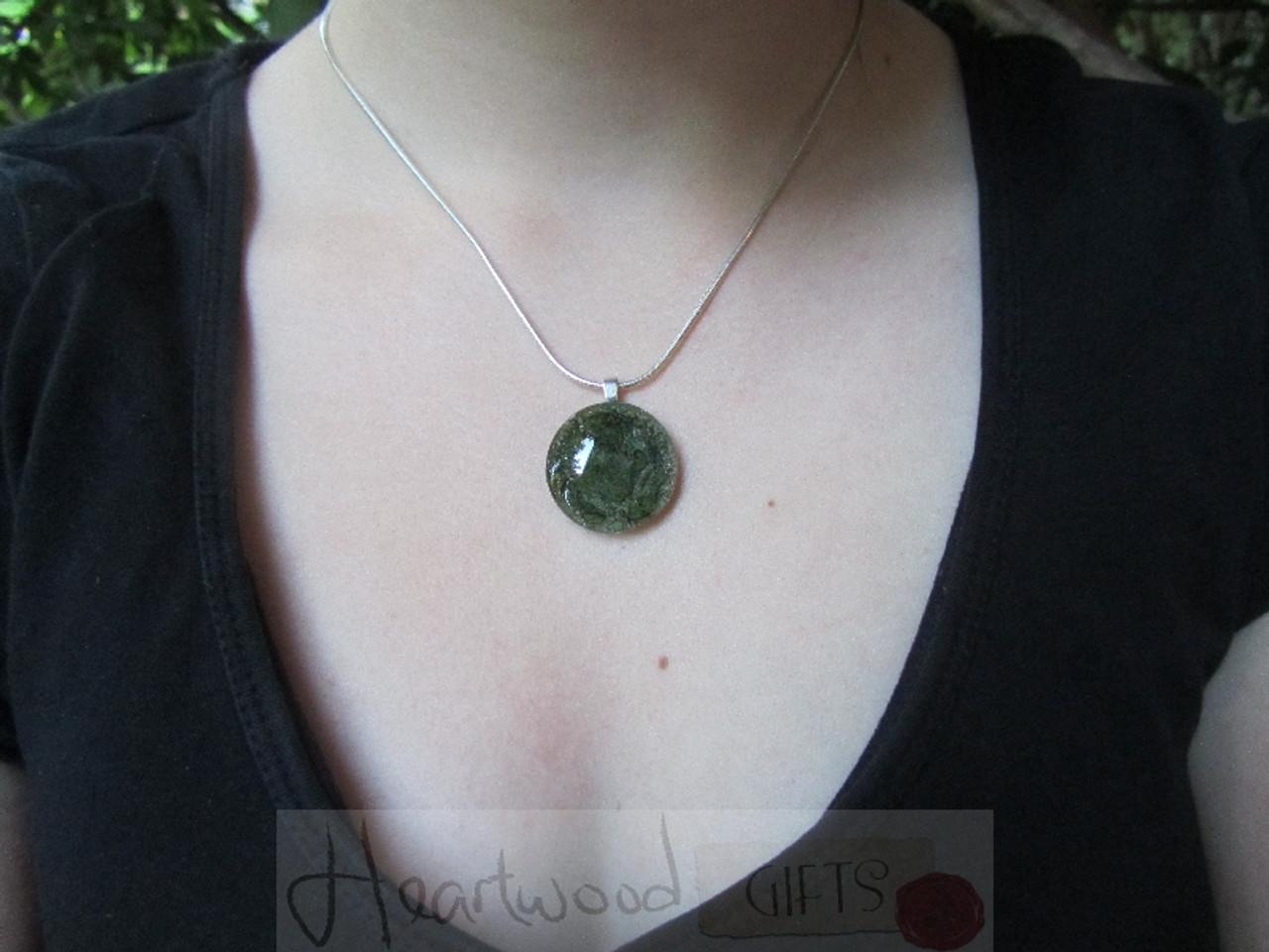 Model with Momo Glassworks Olive Glass Medallion