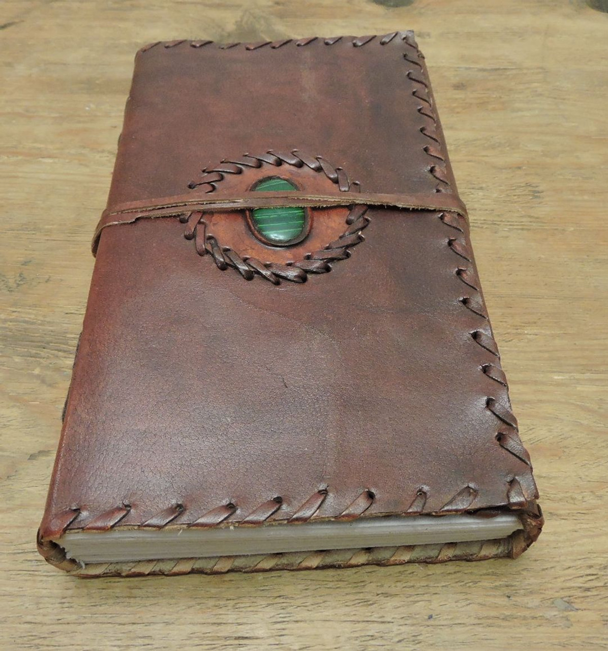 bottom view of handcrafted leather journal with semi precious stone and stitching