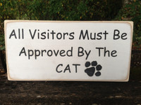 All Visitors Must Be Approved By The Cat wood sign